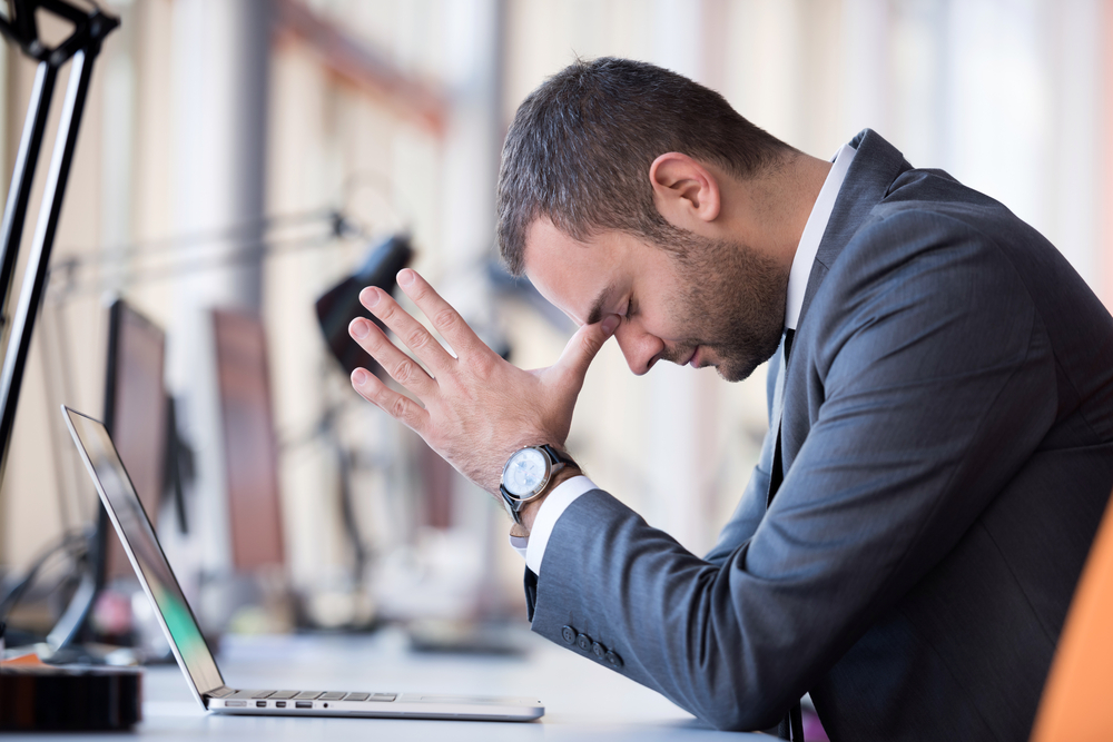business man frustrated headache