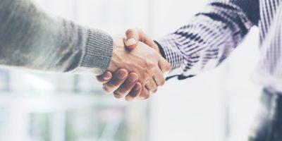 Business partnership handshake meeting concept