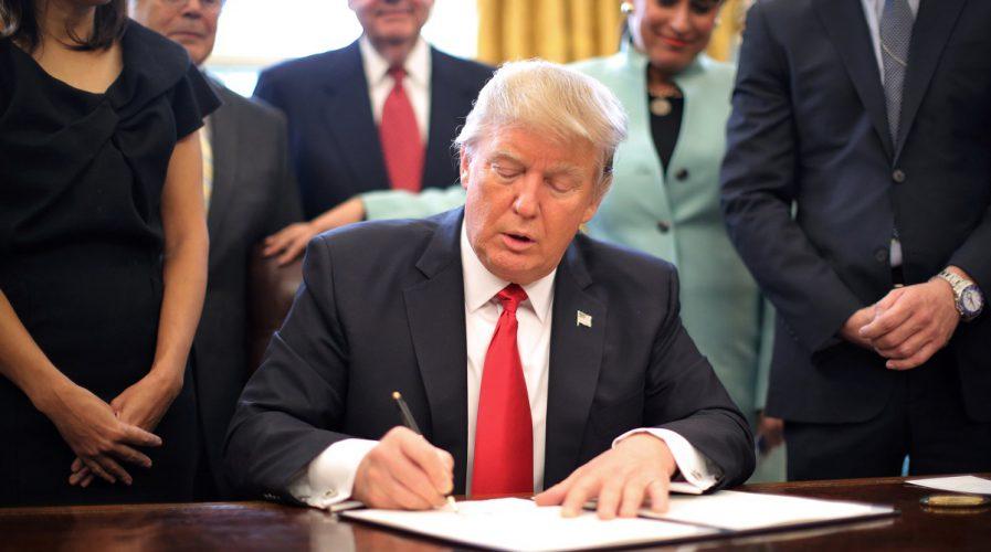 us president donald trump signing executive order
