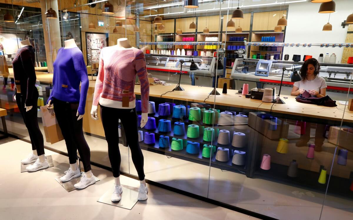 34636277e2d0 Adidas introduced an in-store knitting machine to empower customers to  customize their own apparel. Source  Reuters