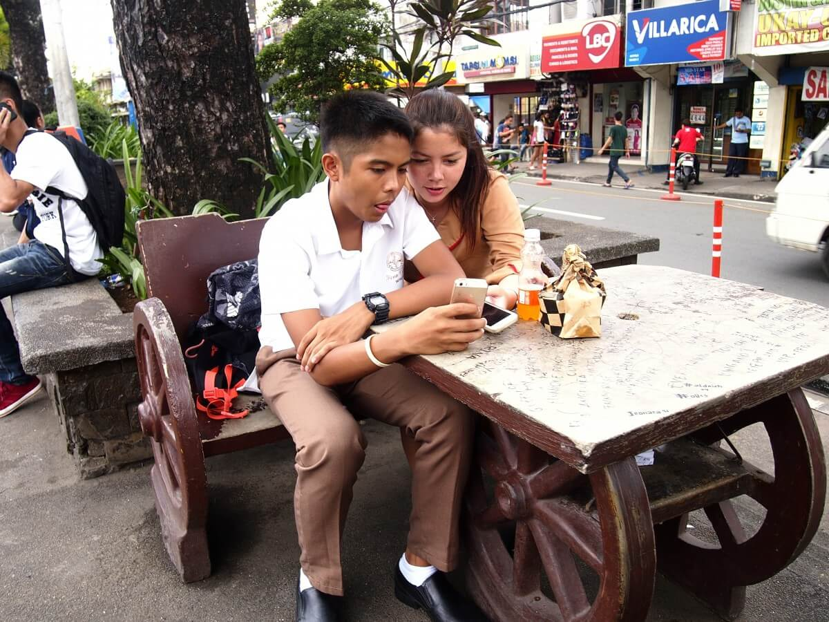 teens on smartphone in Philippines