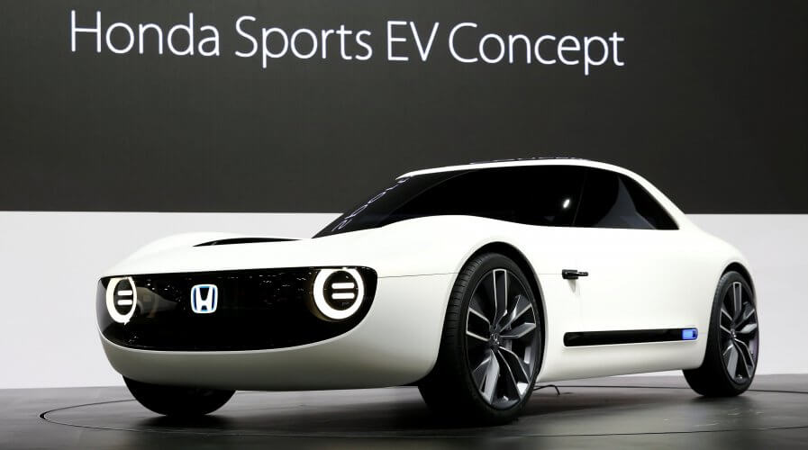 Japan caves in to electric cars, but aren't giving up on ...