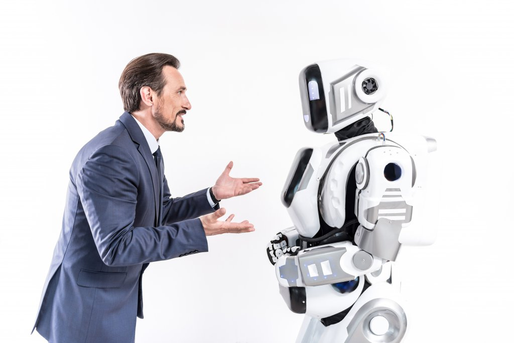 man teaches robot