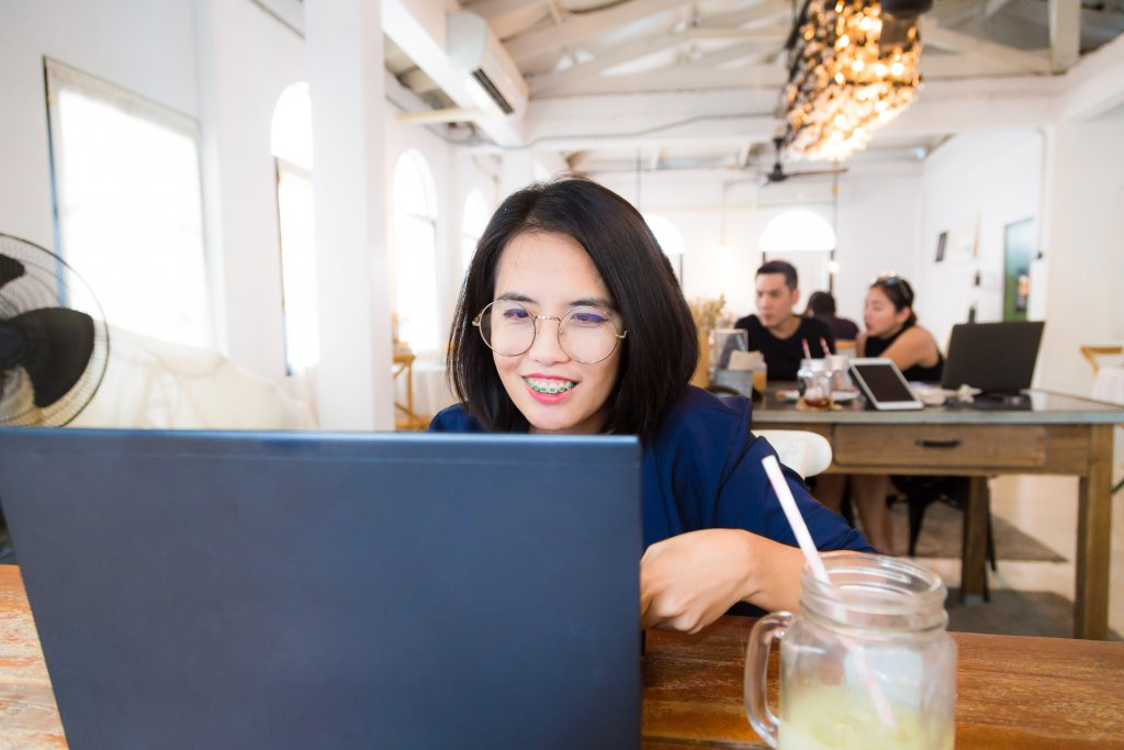 email asian smiling laptop