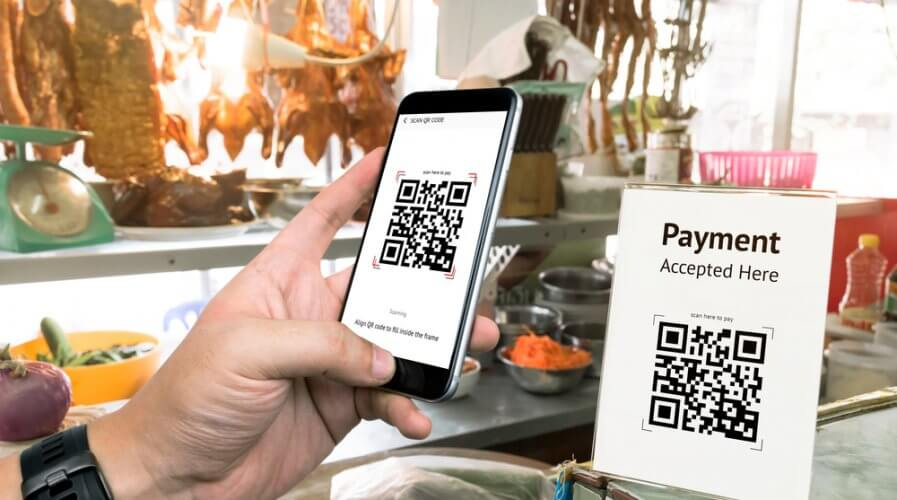 a person scanning a qr code at a hawker stall