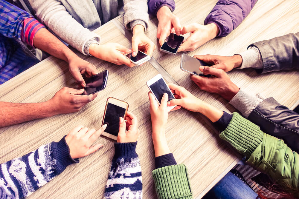 a group of people using mobile phones.