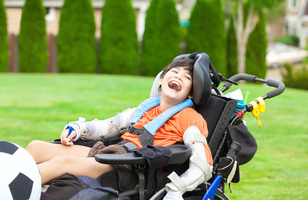 a disabled boy in a wheelchair