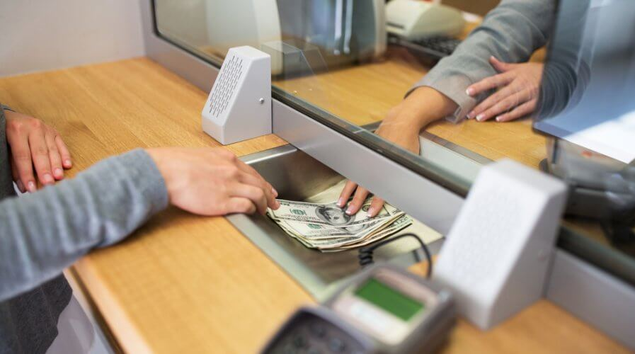 a banking counter with someone withdrawing money