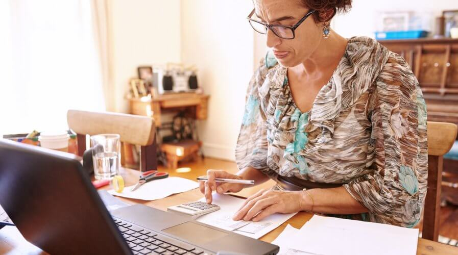 a woman doing accounts manually