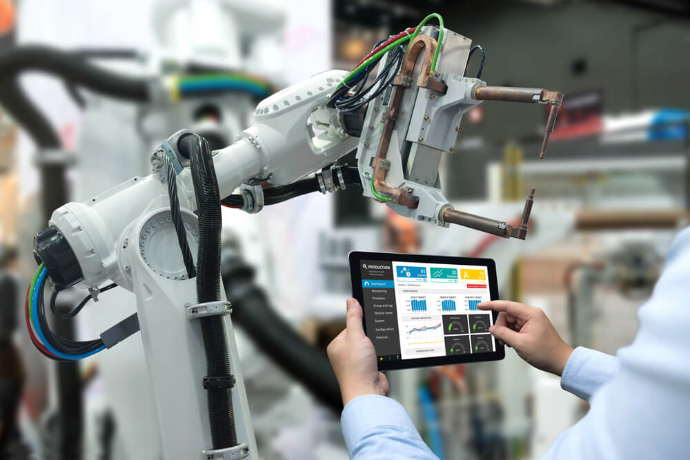 an engineer working with a robotic arm