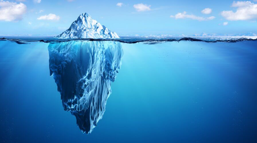 a picture with an iceberg with most of it underwater
