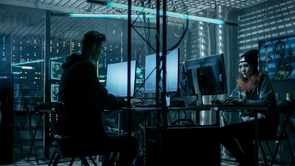 a team of hackers working in a dark room
