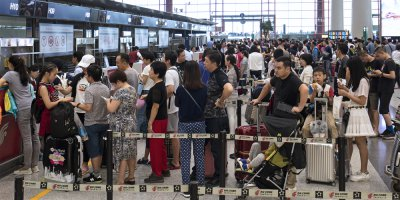 crowds at a beijing airport