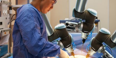 a doctor operates with the help of precision robots