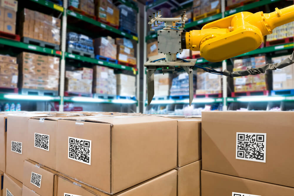 a warehouse holding goods with QR codes