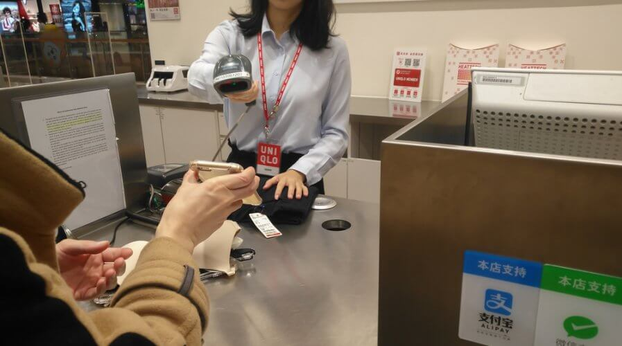 a person making payment with WeChat Pay