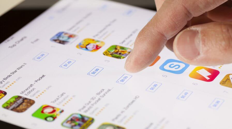 a person browsing for apps in the app store on a tablet