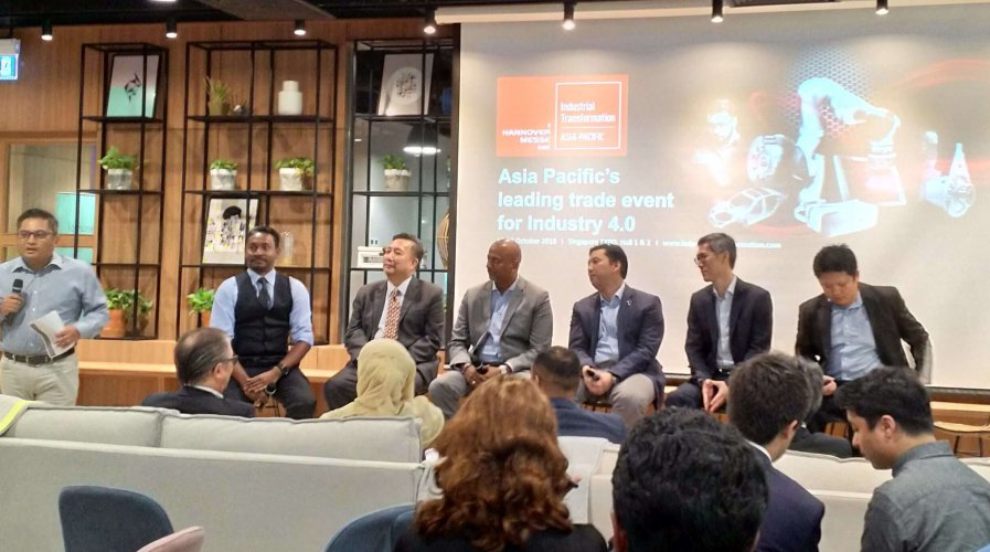 panelists speaking at a local event