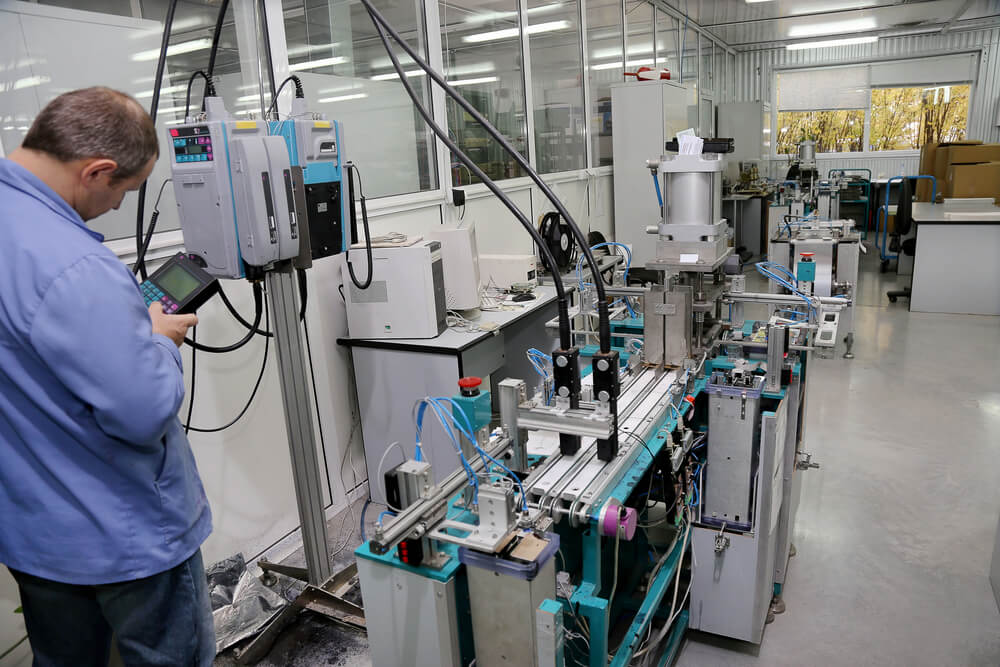 a worker using smart devices to operate machinery