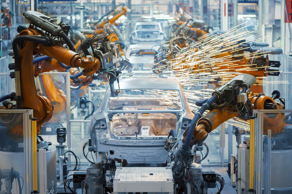 a car manufacturing line using robots and automation