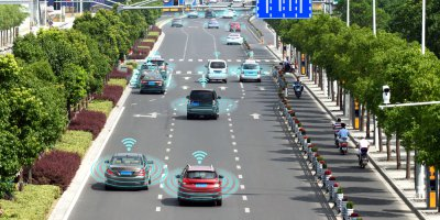 self driving cars on the road communicates with each other to make traffic smoother
