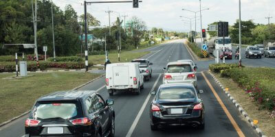 cars stopping at a traffic light