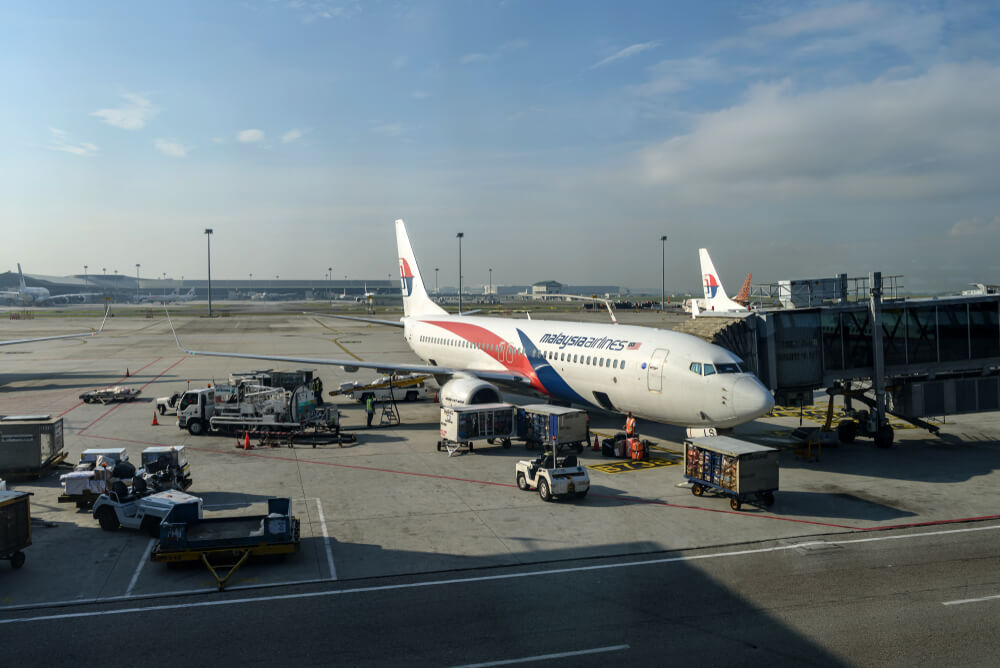 a flight docked at the gate at KLIA