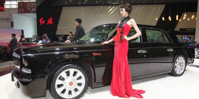 "(FIle) Models pose with a Hongqi L5 car on display at the China International Exhibition Center new venue during the ""Auto China 2014"" Beijing International Automotive Exhibition in Beijing on April 20, 2014. Source: AFP"