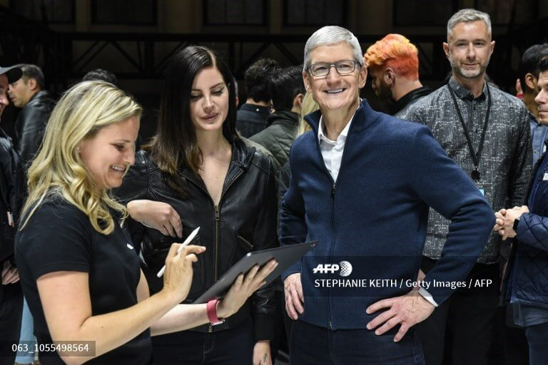 (FILE) Tim Cook, CEO of Apple stands with Lana Del Rey (C) during a launch event at the Brooklyn Academy of Music on October 30, 2018 in New York City. Source: AFP