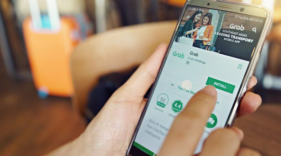 Grab partners with ZhongAn to bring digital insurance to the Southeast Asia market. Source: Shutterstock
