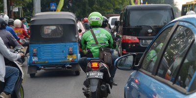 Ride-hailing motorcycles will still be the most cost-efficient mode of transportation for business users.Source: AFP