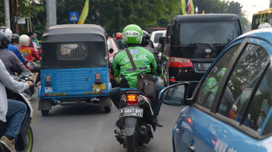 Ride-hailing motorcycles will still be the most cost-efficient mode of transportation for business users. Source: AFP