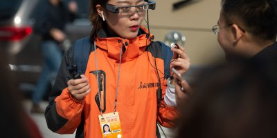 AI-powered augmented reality glasses can help China break the infection chain. Source: AFP