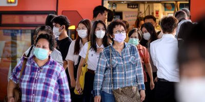 Commuters with face masks at a busy train station in Thailand. Source: AFP.
