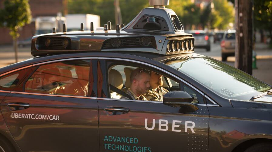 An Uber driverless Ford Fusion cruises down a street in Pittsburgh. Source: AFP.