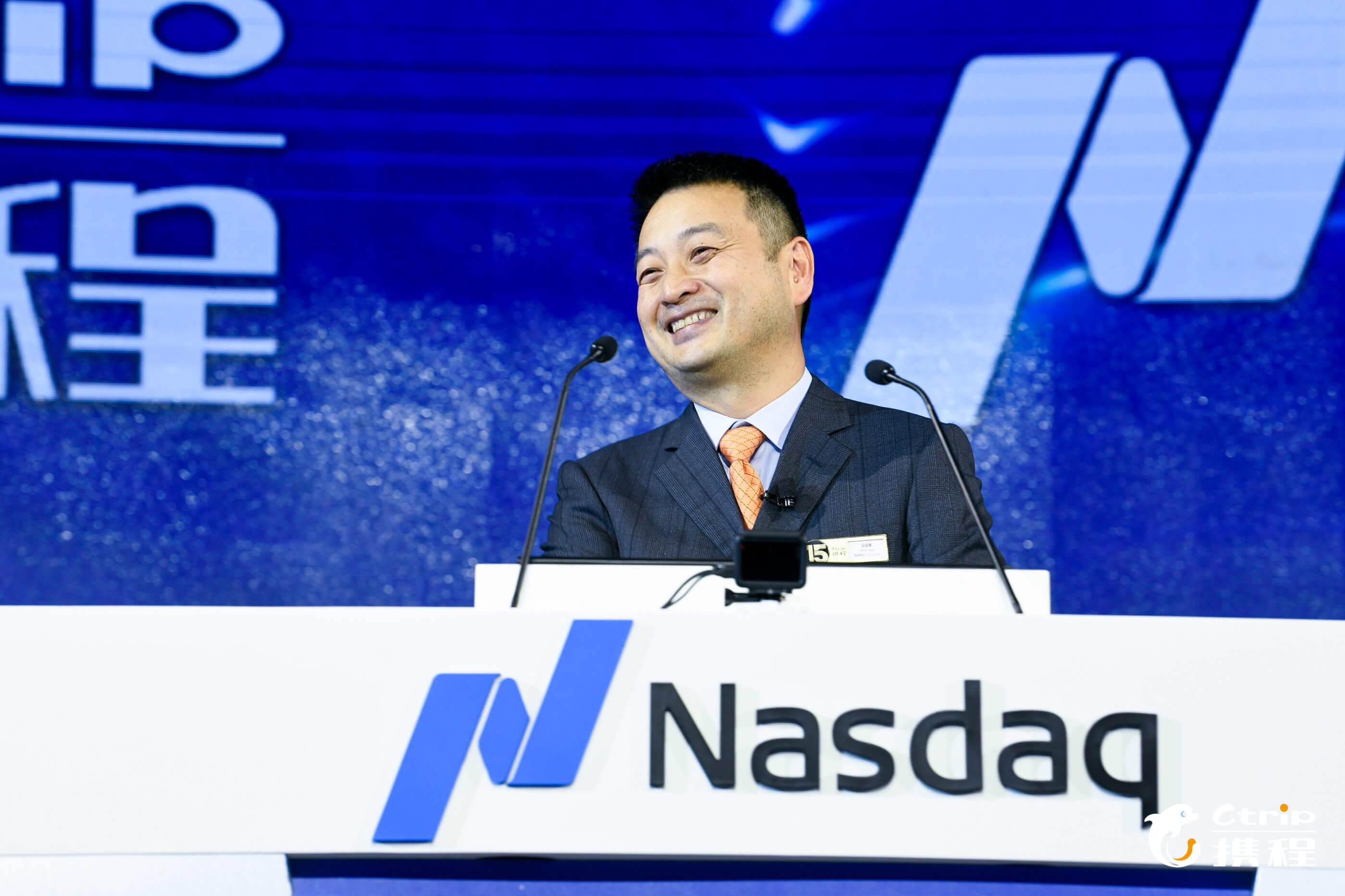 Trip.com chairman James Liang at a conference. Source: Ctrip.com