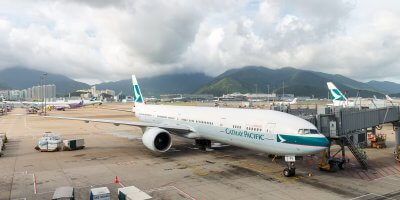 A Cathay Pacific flight docked at Hong Kong International Airport. Source: Shutterstock.