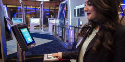 """An attendant does the test of facial recognition using biometry technology in the """"innovation hub"""" of Istanbul airport. Source: AFP"""