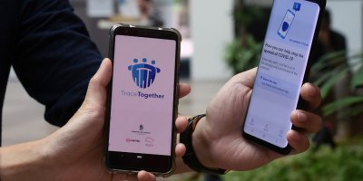 Government Technology Agency (GovTech) staff demonstrate Singapore's new contact-tracing smarthphone app called TraceTogether, as a preventive measure against the COVID-19 coronavirus in Singapore