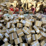 Workers sorting out packages for Single's Day Sale, one of the largest e-commerce events. Source: AFP.