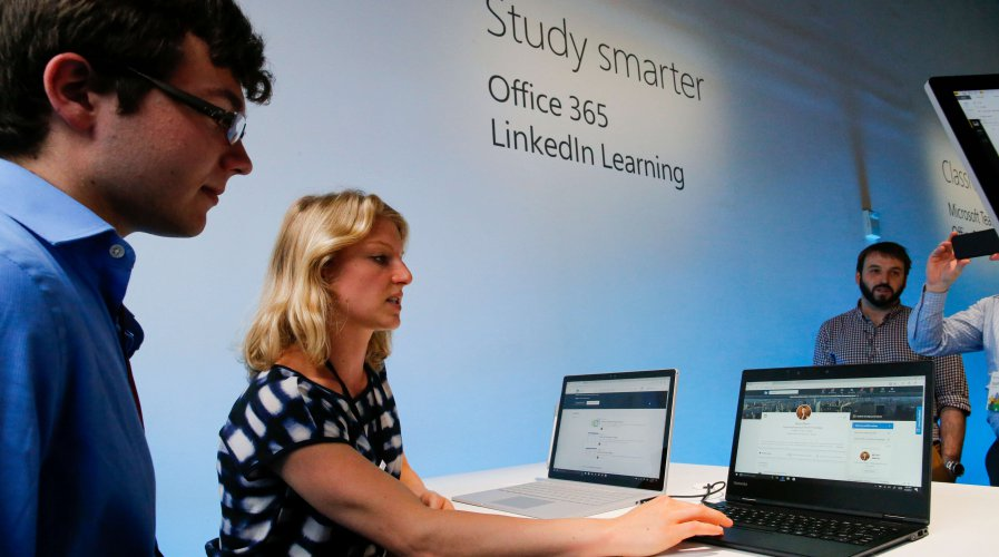 Members of the LinkedIn Learning team showing how the online learning platform can help students prepare for their job search. Source: AFP