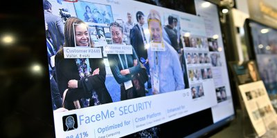 A video monitor displays attendees captured with CyperLink's facial recognition tech at CES 2020